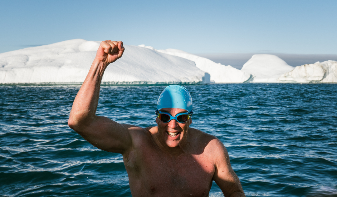 Lewis Pugh swims through ice fjord in Greenland